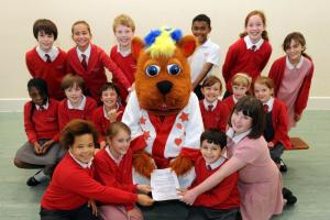 Benny Bear drops in for a sing at West Ewell primary school (From ...