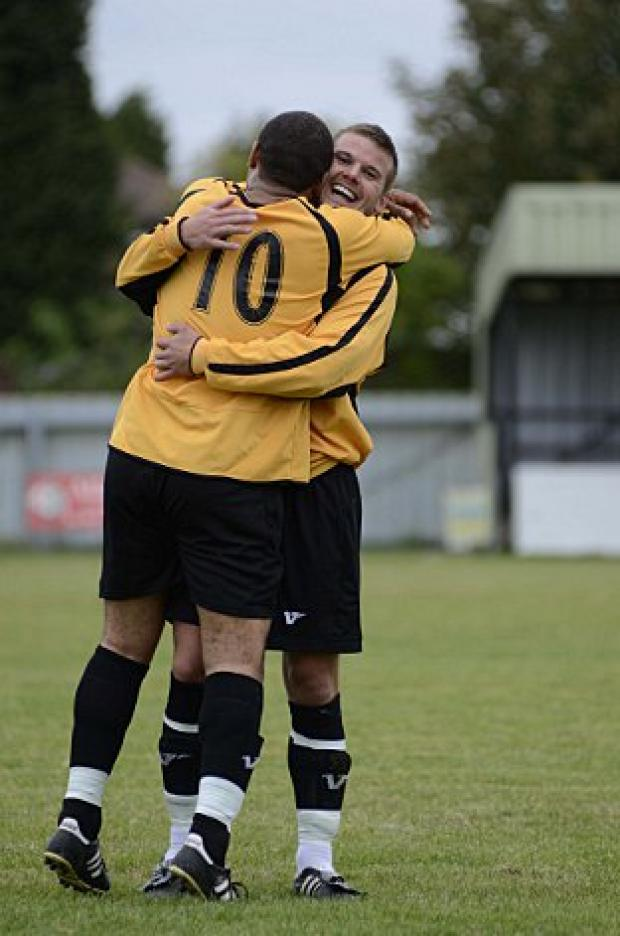 Happier times: Leon McDowell (10) celebrates his strike against Cove with Taylor Mollatt