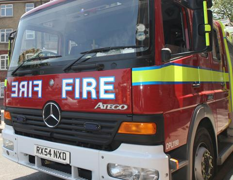 Two escape Epsom garage fire