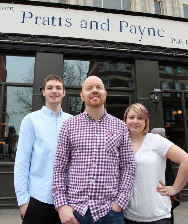 Manager Damien Omen (middle) with members of pub staff.