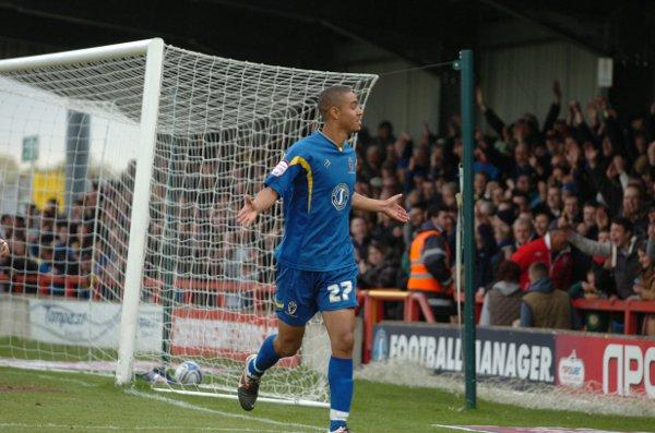 Signing off in style: Byron Harrison celebrates his goal against Shrewsbury