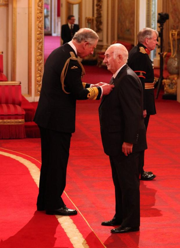 Honour: Charlie Lister receives his OBE from Prince Charles. Dominic Lipinski/PA Wire