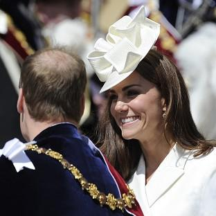 The Duchess of Cambridge smiles at her husband after attending the annual Order of the Garter Service in Windsor
