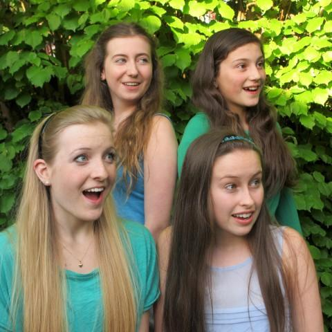 Four young actors playing the Alice in different performances - Chrissy Armitage, Freya Clarke, Vicky Hillman and Nina Ridge.