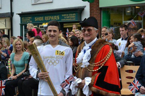 Aydin Djemal, from Epsom, carried the torch through Reigate