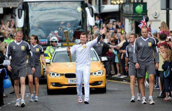 Tim Lawler, from Tadworth, carried the Olympic torch through Dorking