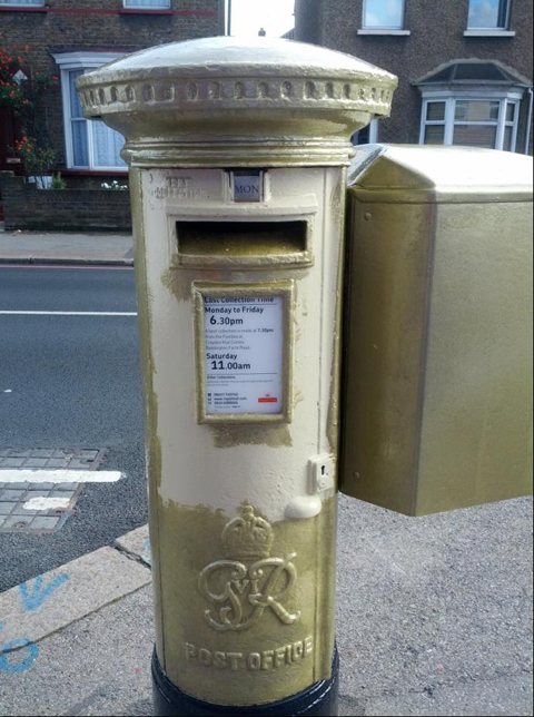 Gold post box in Carshalton