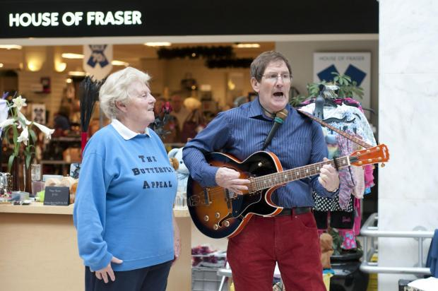 Busking councillor entertains shoppers for second time in Epsom