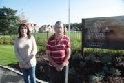 Gerald Carpenter and his daughter Lydia in front of the development