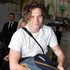 Epsom Guardian: Brooklyn Beckham supported by parents Victoria and David at book event