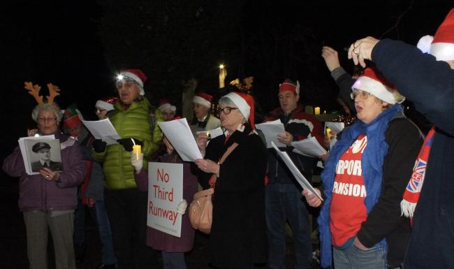 The campaigners sang adapted carols outside the Transport Secretary's house.