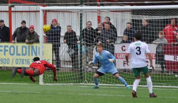 Carshalton Athletic's Ola Sogbanmu heads goalwards in the 0-0 draw with Guernsey. Picture: Ian Gerrard