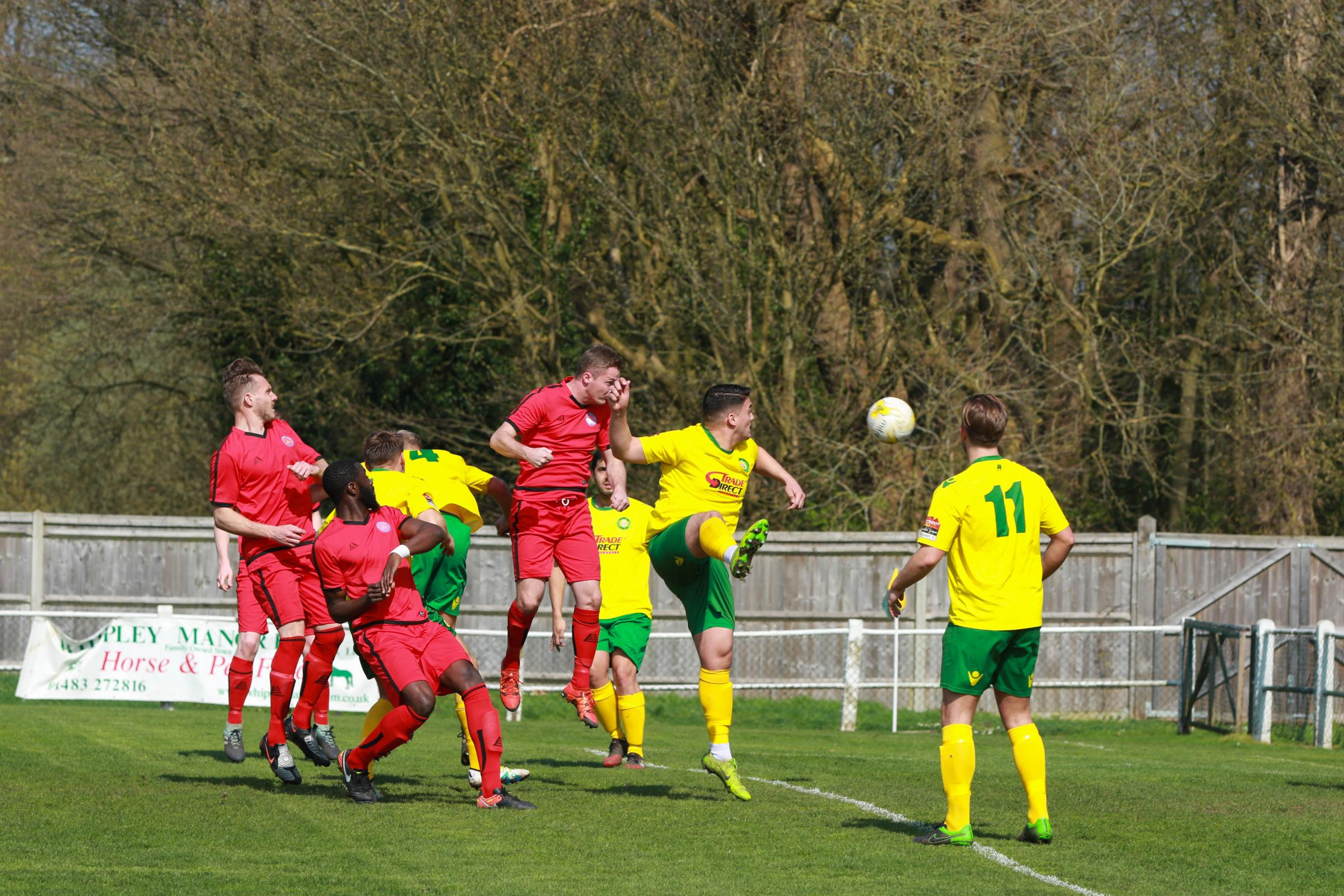 Daryl Cooper-Smith heads home to put Sutton Common Rovers ahead at Godalming Town