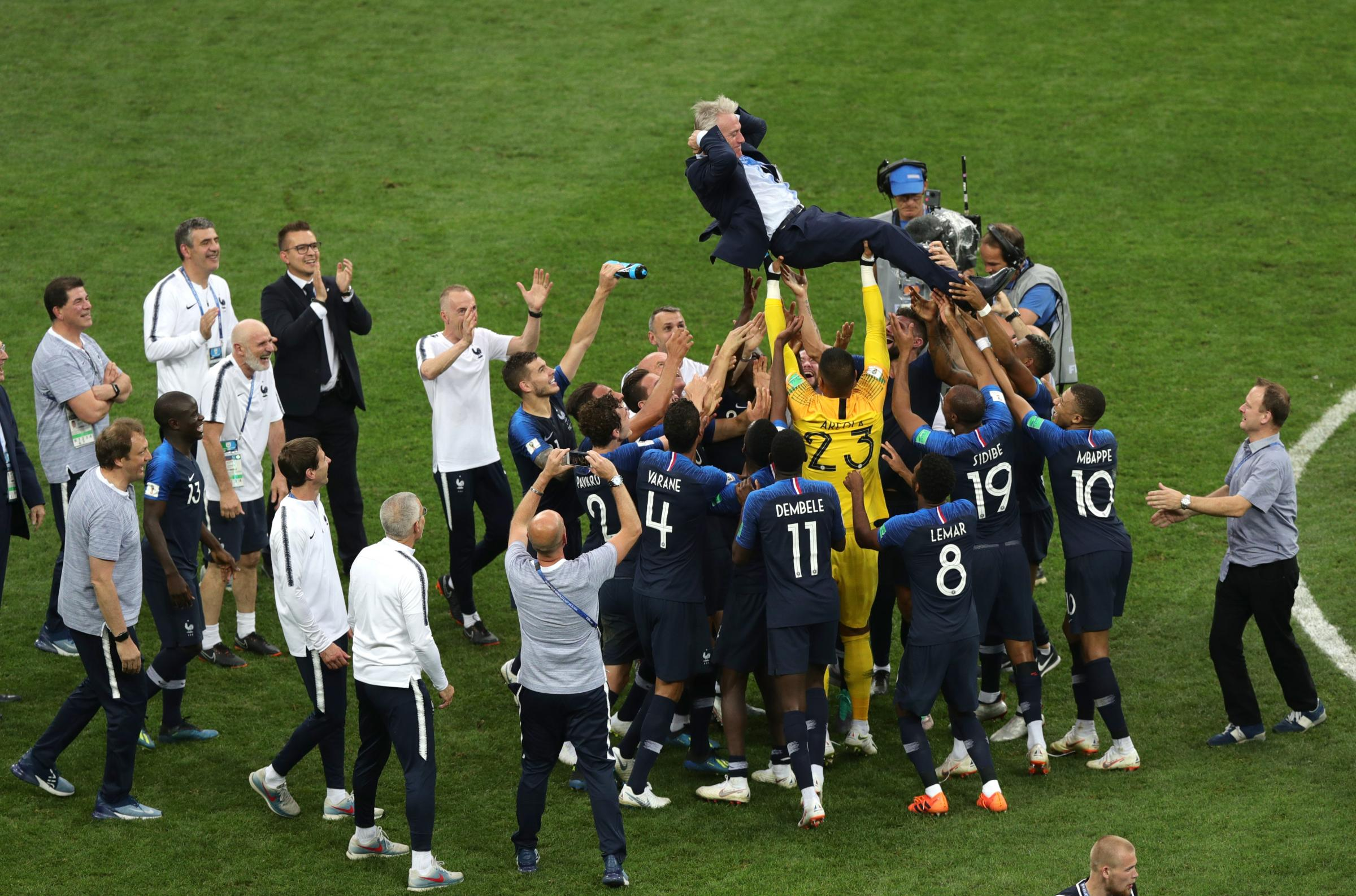 France manager Didier Deschamps is thrown into the air by his players after victory in the World Cup final (Aaron Chown/PA)